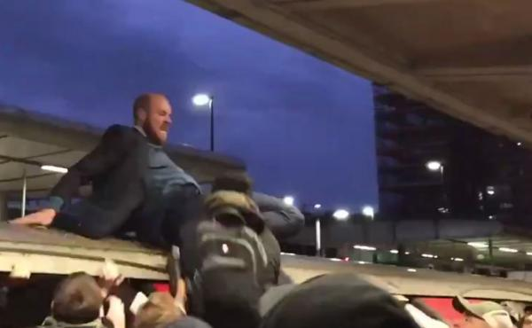 A video posted to Twitter showed a climate protester being pulled from atop a train car onto the platform below, where he appeared to be pummeled by angry commuters on Thursday in London.