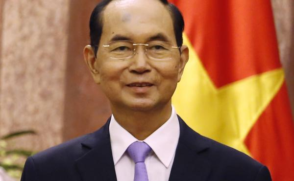 Vietnam's President Tran Dai Quang shown during a meeting with Myanmar's leader Aung San Suu Kyi at the Presidential Palace during the World Economic Forum on ASEAN in Hanoi, Vietnam. Quang died Friday at age 61 due to illness.