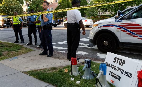 Police secure the street outside the Turkish Embassy in Washington, D.C, on Tuesday. Nine people were injured when a fight broke out during a demonstration outside the embassy. Turkish President Recep Tayyip Erdogan was in town to meet President Trump at