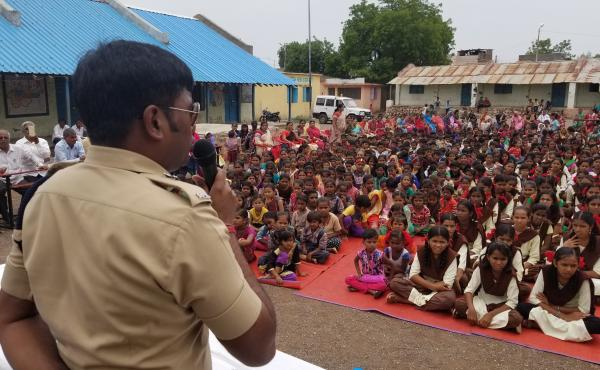Harssh Poddar, a senior police official, addresses a village meeting at a rural school near Malegaon, in northern Maharashtra state. He warns families to be skeptical of what they read online. Earlier this month, Poddar helped rescue five people from bein