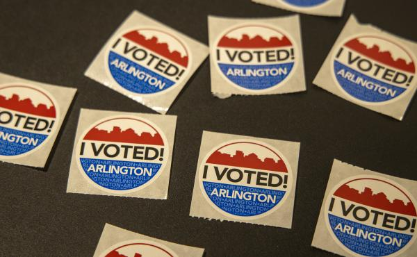 """""""I voted"""" stickers at the Arlington Art Center in Arlington, Virginia. Several prominent Virginians including Lt. Gov. Justin Fairfax are calling for an extension to the voter registration deadline."""