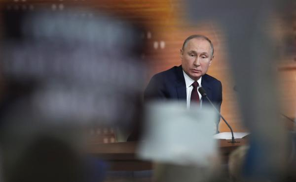 """Russian President Vladimir Putin speaks Thursday during his annual news conference in Moscow. During the four-hour session, the longtime Russian leader called the U.S. impeachment process """"far-fetched,"""" making the prediction that Donald Trump will be acqu"""