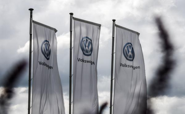 The logo of German automaker Volkswagen appears on flags fluttering in front of a car dealer in Hamm, Germany, in May. One of VW's many legal settlements over the Dieselgate scandal has finally reached its conclusion, the FTC says.