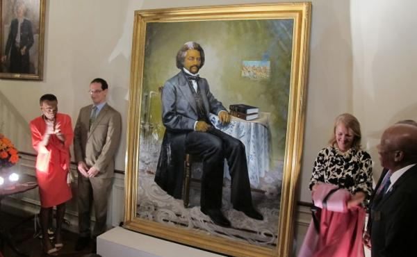 A portrait of 19th-century abolitionist Frederick Douglass is unveiled at the Maryland governor's residence in Annapolis on Sept. 15, 2014.