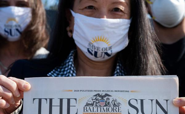 Baltimore Sun reporter Jean Marbella participates in a Save Our Sun rally in March, part of an effort to secure an alternative buyer to Alden Global Capital.