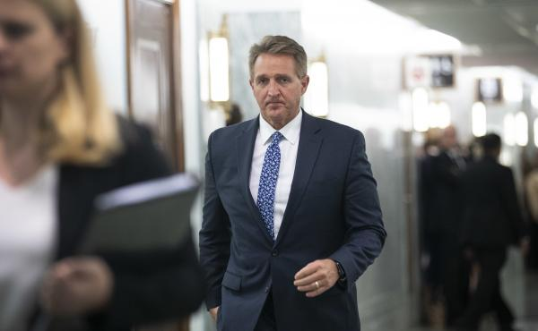 Sen. Jeff Flake arrives back at the Senate Judiciary Committee hearing on Thursday following a break. After announcing Friday morning that he would vote to confirm Brett Kavanaugh to the Supreme Court, Flake was confronted in an emotional scene by two wom