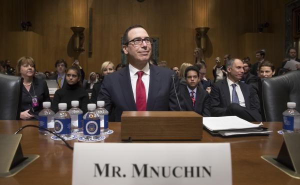 Treasury Secretary nominee Steven Mnuchin testifies at a confirmation on Capitol Hill. He faced tough questioning from Democrats over his running of a bank that profited from the housing crisis.