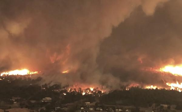 """This still frame from a video released earlier this week by Cal Fire shows the """"fire tornado"""" forming over Lake Keswick Estates near Redding, Calif., on July 26."""