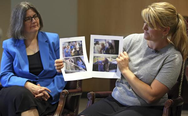 Nurse Alex Wubbels (right) displays video frame grabs of herself being taken into custody while her attorney, Karra Porter, looks on during an interview Friday. Wubbels was arrested after she told a police detective it was against hospital policy to condu