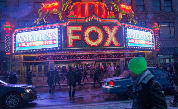 People begin arriving at the Fox Theatre for the Republican presidential debate sponsored by Fox News on Thursday in Detroit.