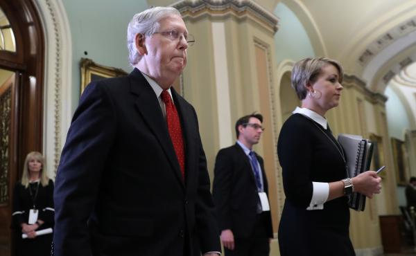 Senate Majority Leader Mitch McConnell, R-Ky., walks out of the Senate Chamber before the start of President Trump's impeachment trial on Tuesday.