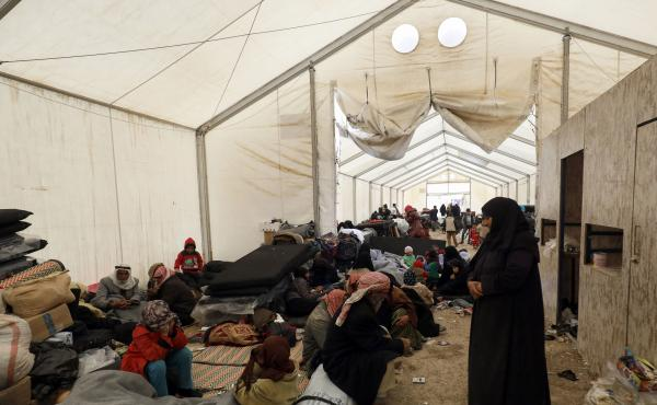 Displaced Syrians gather inside a tent in the Al-Hol camp in northeastern Syria in December.