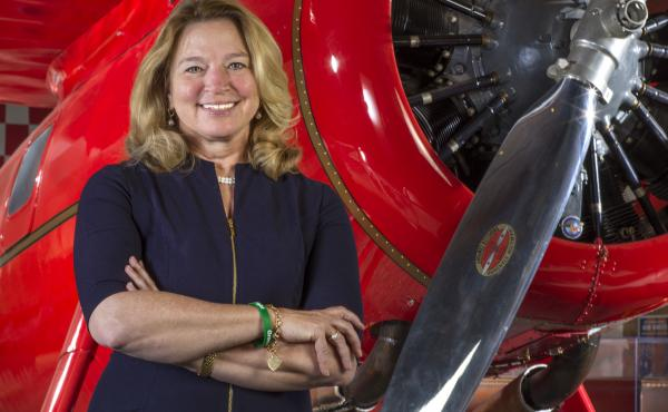 Ellen Stofan stands in front of Amelia Earhart's Lockheed 5B Vega at the National Air and Space Museum in Washington, D.C., June 26, 2018.