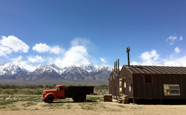 Two reconstructed buildings stand in the former Manzanar War Relocation Center. Once, 10,046 people were imprisoned here.