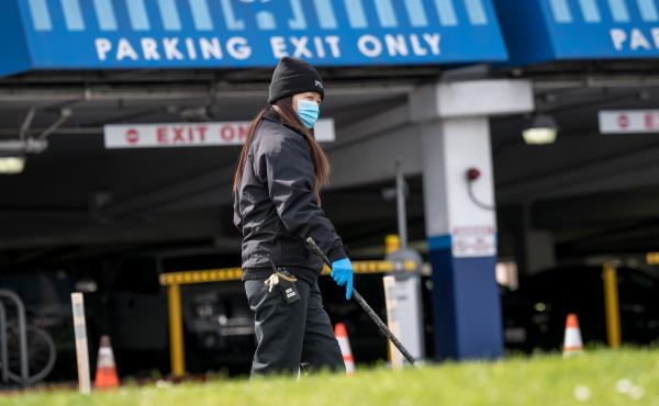 A Pier 39 employee wears protective gear while cleaning a sidewalk in San Francisco, Calif., on March 16, the day the county announced a local shelter-in-place order. On March 19, California Gov. Gavin Newsom announced a shelter-in-place order for the ent