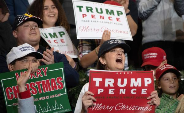 Supporters cheer as President Trump speaks during a rally in Mississippi in November.