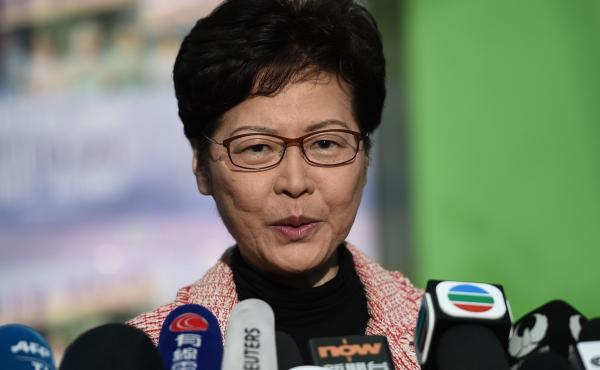 "Hong Kong Chief Executive Carrie Lam addresses the media after casting her vote during Sunday's district council elections. After results showed a landslide victory for pro-democracy candidates, Lam said she would listen ""humbly"" to the will of the voters"