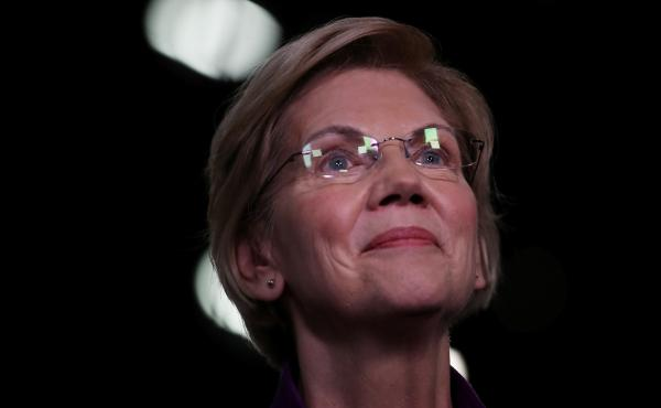 Sen. Elizabeth Warren, D-Mass., speaks to the media in the spin room after the first night of the Democratic presidential debate in Miami last month.