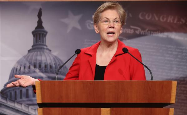 Sen. Elizabeth Warren holds a news conference in March. She and Sen. Bernie Sanders are leading the push to introduce a bill Tuesday that would make pandemic-related food benefits for college students permanent and create grants for colleges to address hu
