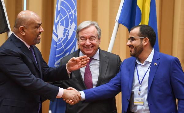 Yemeni Foreign Minister Khaled al-Yamani (left) and head rebel negotiator Mohammed Abdelsalam (right) shake hands under the eyes of U.N. Secretary-General António Guterres, during peace talks Thursday at Johannesberg Castle in Rimbo, Sweden.