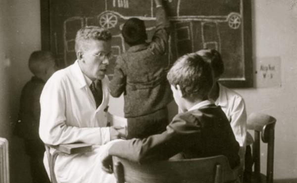 Dr. Hans Asperger with a young boy at the Children's Clinic at the University of Vienna in the 1930s.