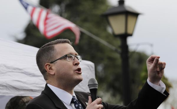 Republican state Rep. Matt Shea, pictured at at a gun-rights rally in January, has been suspended from the House Republican Caucus. He was also removed from several committees.