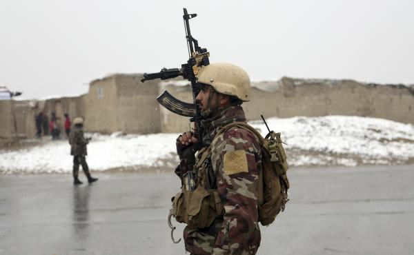 A member of the Afghan security forces stands guard at the site of an attack on Monday in Kabul, Afghanistan.
