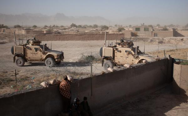 U.S. soldiers enter a compound for a security meeting in Shah Joy District, Zabul Province, Afghanistan in the fall of 2010.