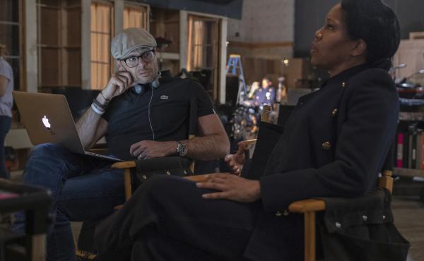 Damon Lindelof and star Regina King on the set of Watchmen.