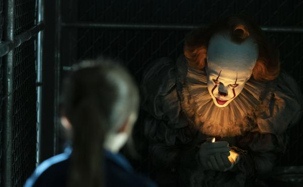 Bill Skarsgård (right) is back as Pennywise to torment the town of Derry one final time...probably.