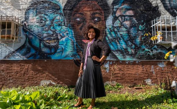 Keitra Bates stands outside of the original location of Marddy's in Atlanta. It's a shared kitchen where home cooks can prepare their goods, and collectively market them.