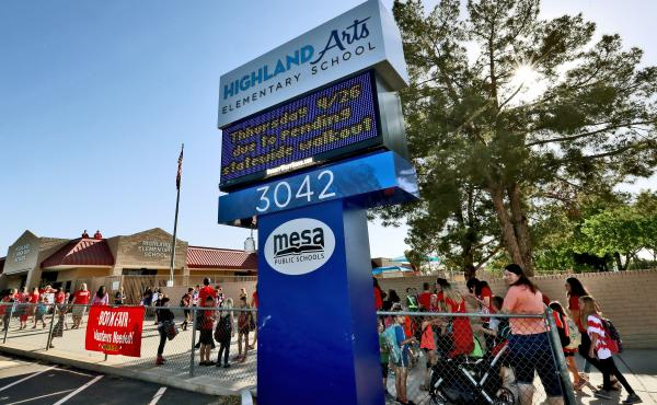 The digital marquee outside Highland Arts Elementary School in Mesa, Ariz., seen at the start of class Wednesday, warns of the effects of the teacher walkout on Thursday.