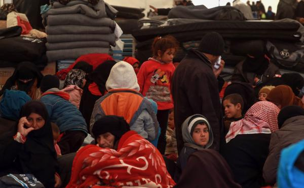 Displaced Syrians gather inside a tent in the al-Hol camp in northeastern Syria on Dec. 8. People fled towns where the U.S.-led coalition is fighting the last remnants of ISIS.