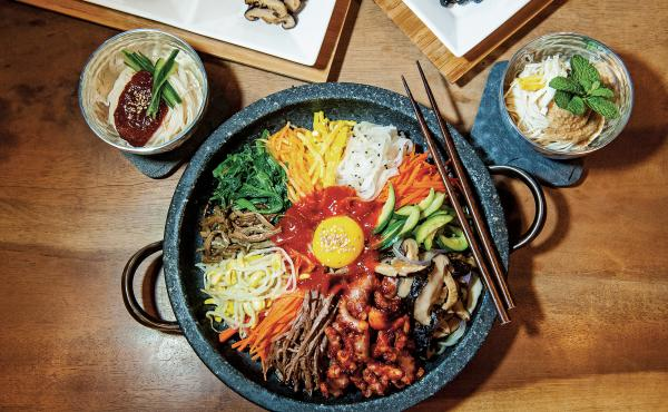 """Bibimbap is one of the best-known Korean dishes. According to chef Deuki Hong and writer Matt Rodbard, there really isn't a definitive recipe. """"The name translates to 'mixed rice,' and, in practice, rice is the dish's only constant,"""" the authors write in"""