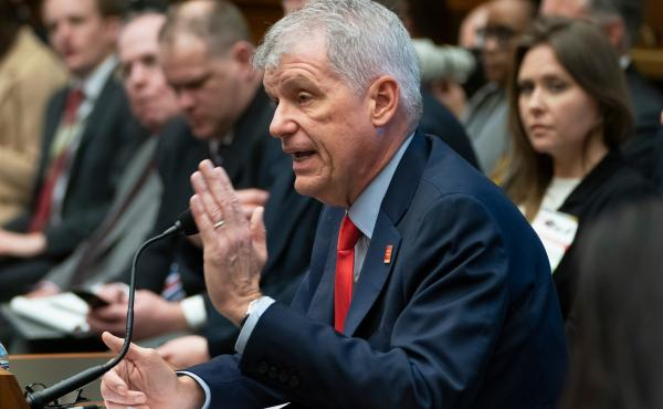 Wells Fargo CEO Timothy Sloan is questioned by the House Financial Services Committee  earlier this month. He will step down immediately, the company announced Thursday.