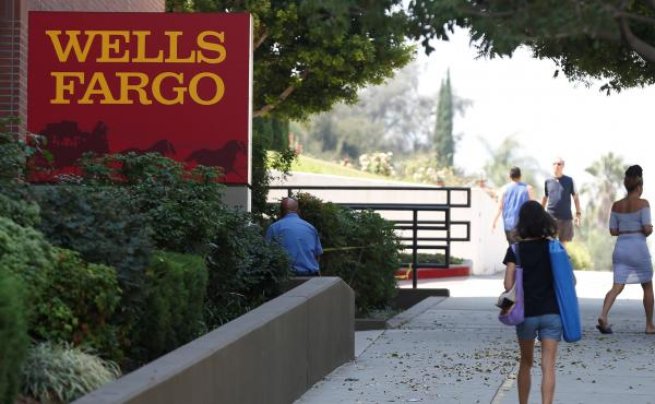 Wells Fargo will pay a $2.09 billion civil penalty for allegedly selling residential mortgage loans that included misstated income information, the Justice Department said.