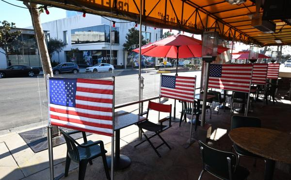 Patio tables are empty at a diner this week in West Hollywood, Calif., after Los Angeles County banned outdoor dining amid the pandemic. The struggles of restaurants and retailers are expected to have led to sharply slower job growth last month.