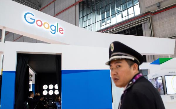 A security guard stands in front of Google's booth at the China International Import Expo earlier this month in Shanghai.