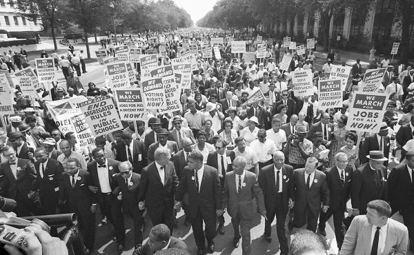 """The clergyman and civil rights leader Martin Luther KIng (3rd from left) and other black and white civil right leaders march 28 August 1963 on the Mall in Washington DC during the """"March on Washington""""."""