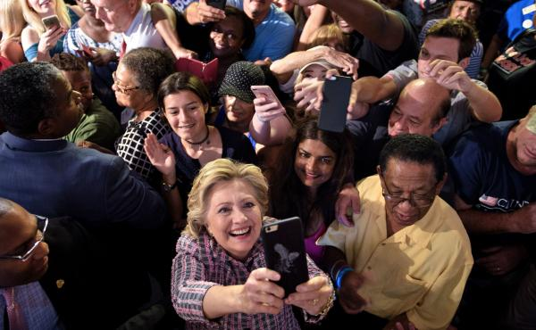 Democratic presidential nominee Hillary Clinton takes a selfie with supporters after speaking at a rally about national service Sept. 30 in Fort Pierce, Fla.
