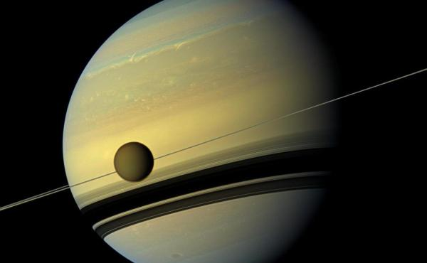 Planetary scientists have many worlds they'd like to visit, including Saturn's moon Titan, which has lakes of liquid methane on its surface.
