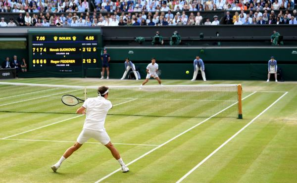 Roger Federer of Switzerland plays a forehand against Novak Djokovic of Serbia during the 2019 Wimbledon men's final on July 14 in London.