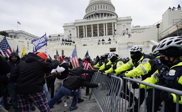 Trump supporters try to break through a police barrier Jan. 6 at the U.S. Capitol in Washington, D.C.