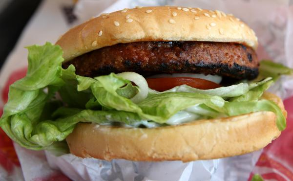 A Beyond Meat burger is displayed at a Carl's Jr. restaurant in San Francisco. The rise of meat alternatives made from plants, as well as meat grown from animal cells in labs, has sparked new laws on food labeling.