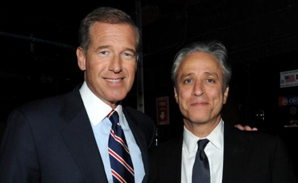 """Brian Williams and Jon Stewart backstage at """"The New York Comedy Festival And The Bob Woodruff Foundation Present: The 7th Annual Stand Up For Heroes"""" event at Madison Square Garden in Nov. 2013."""