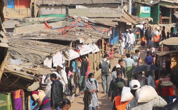 Rohingya refugees walk at the Balukhali refugee camp in Cox's Bazar, Bangladesh, on Feb. 2. Rohingya refugees from Myanmar living in camps in Bangladesh are condemning the military coup in their homeland and saying it makes them more fearful to return. A