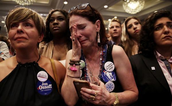 Jon Ossoff supporter Jan Yanes, center, cries as the Democratic candidate for the 6th congressional district special election in Georgia concedes Tuesday night.
