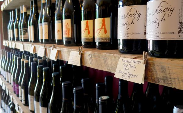 Bottles for sale at Passage de la Fleur, a natural wine shop in Brooklyn, N.Y. For some, natural wines must be completely unadulterated — without the use of sugar, clarifiers or other additives common in modern winemaking. Other natural winemakers, howe