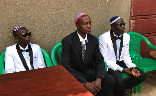 Shadrach Mugoya Levi, right, at his recent wedding in Uganda. From left: his son Oren Levi and Moshe Isiko.