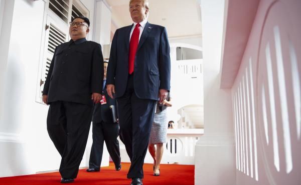 North Korea's leader Kim Jong Un and President Trump walk together at a resort on Sentosa Island in Singapore on June 12, 2018.